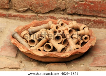 Ceramic tray with cups for hookahs. Bhaktapur, Nepal. - stock photo