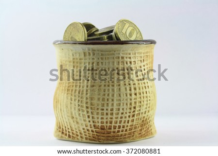 ceramic vase with russian coins  - stock photo