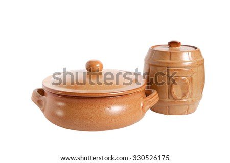 Ceramic ware pan and barrel photographed against a white background - stock photo