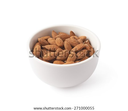 Ceramic white bowl full of almond seeds isolated over the white background - stock photo