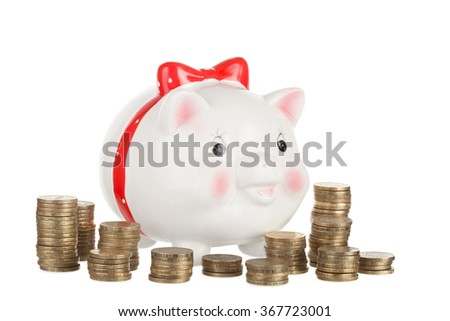 Ceramic white pig moneybox and gold coins on white background