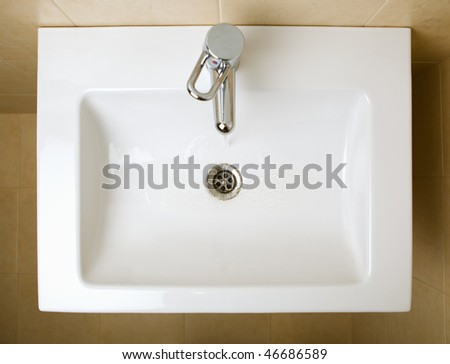 ceramic white washing sink - stock photo