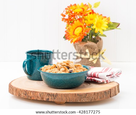 Cereal and coffee served in a tin bowl and cup. - stock photo