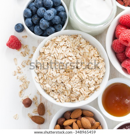 cereal and various delicious ingredients for breakfast, top view, closeup - stock photo