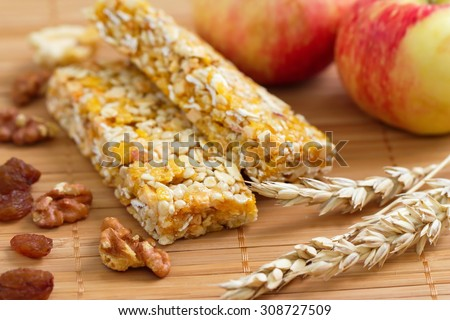 Cereal bars of granola with apples, nuts and raisins - stock photo