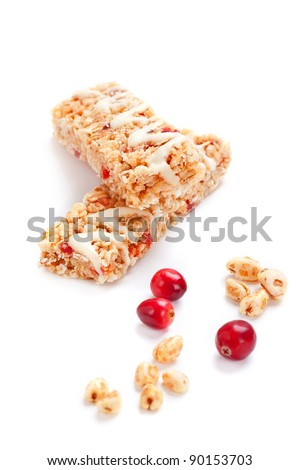 Cereal bars with puffed wheat and cranberries, closeup shot - stock photo