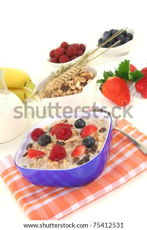 Cereal bowl with milk, fresh fruits and nuts on white background