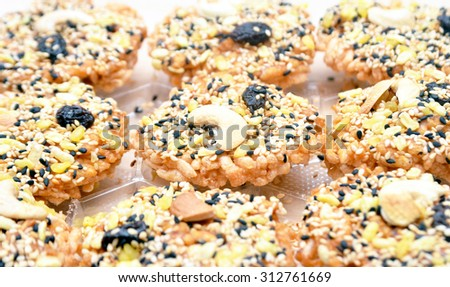 Cereal cookies,This image focus on the deep fried mango seeds on the cookie - stock photo