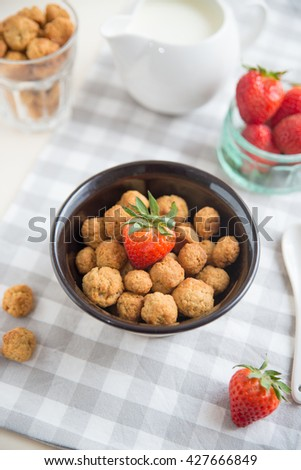 cereal flakes with fresh berries and milk for breakfast - stock photo
