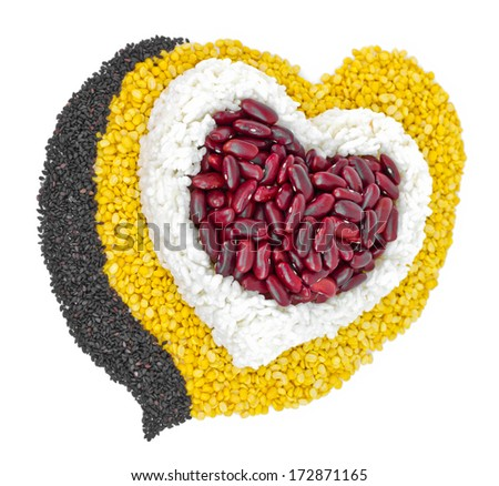 Cereal Grains in to a heart shaped, red beans, green beans, rice, black sesame seeds on white background. - stock photo