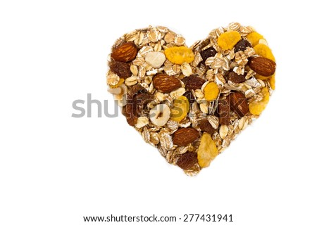 Cereal Muesli heart shaped on white background. Selective focus - stock photo