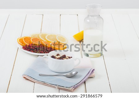 Cereal on white wooden table. Selective focus and small depth of field. - stock photo