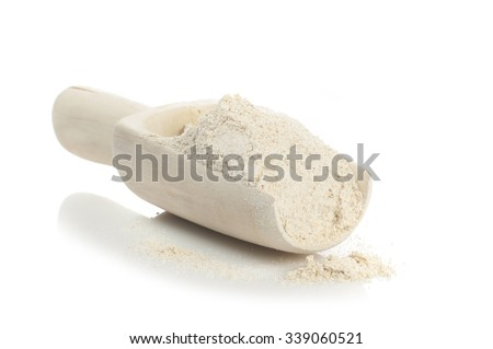 Cereal seria: Oatmeal flour in wooden scoop isolated on white background