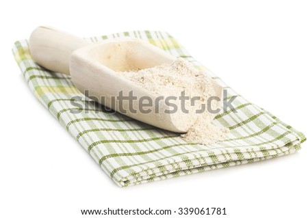 Cereal seria: Oatmeal flour in wooden scoop on checked napkin isolated on white background - stock photo
