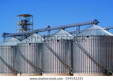 Cereal silos under the blue sky - stock photo