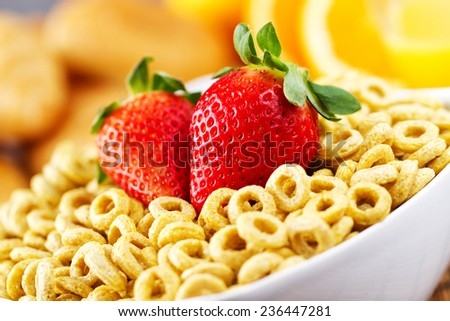 Cereal with milk and strawberries - stock photo