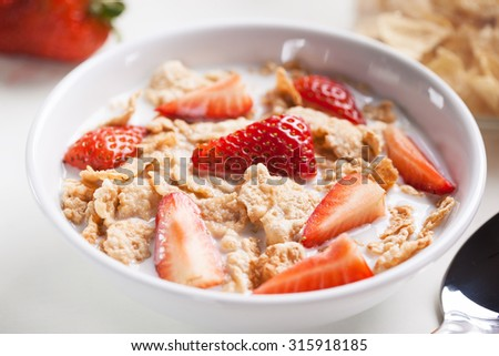 cereal with strawberry for breakfast - stock photo