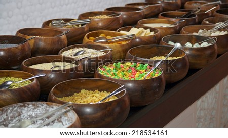 Cereals and Corn Flakes on a Breakfast Buffet. Cereal bar. Breakfast buffet restaurant food in a hotel. - stock photo