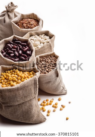 Cereals in bags on white. - stock photo