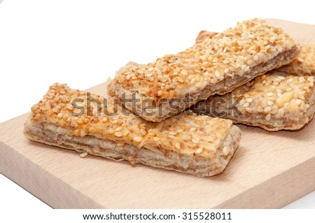 CEREALS MEATLESS BREAD SESAME WOODEN BOARD. - stock photo