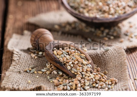 Cereals (wheat, rye, barley, oat and millet) on dark wooden background - stock photo