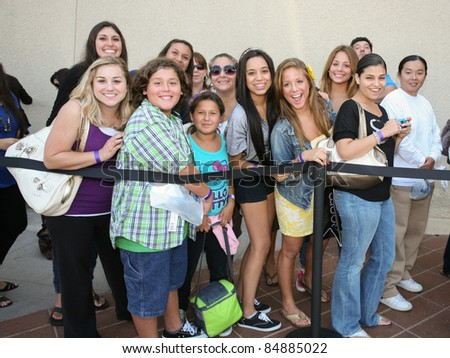 "CERRITOS, CA - SEPTEMBER 18: Fans line outside of Sears to meet the Kardashian sisters for the launch of their brand new clothing line, ""Kardashian Kollection"" in Cerritos, CA on September 18, 2011."