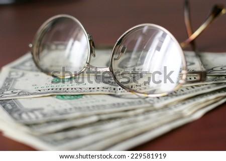 certain amount of the small dollars on dark background - stock photo