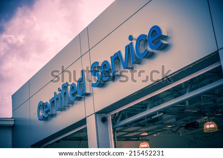 Certified Car Service Gates and Large Entrance Sign. Auto Service Theme. - stock photo