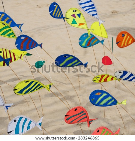 CERVIA, ITALY - APRIL 26, 2015: Colorful fish for International Kite Festival. This Festival brings together kite flyers from all over the world every year since 1981. - stock photo