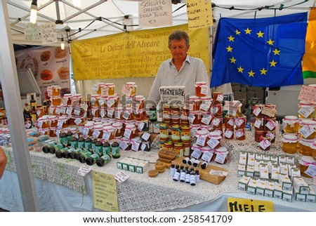 CERVIA, ITALY-SEPTEMBER 21, 2014: delights of the beehive stand at the annual International food outdoor market. This market is very popular and attract thousands of tourists. - stock photo