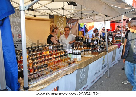 CERVIA, ITALY-SEPTEMBER 21, 2014: typical Modena vinegar stand at the annual International food outdoor market. This market is very popular and attract thousands of tourists. - stock photo