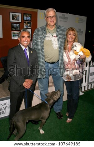 Cesar Millan with Phil Jackson and Jeanie Buss  at the party to celebrate the 100th Episode of 'Dog Whisperer'. Boulevard 3, Hollywood, CA. 09-17-08 - stock photo