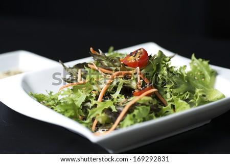 cesar salad on black background - stock photo