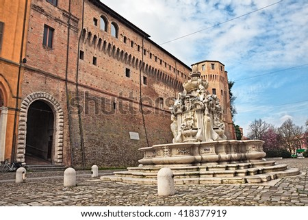 Cesena, Emilia Romagna, Italy: the ancient fountain Fontana del Masini  (16th century) and the fortified palace Rocchetta di Piazza (15th Century) in the old town
