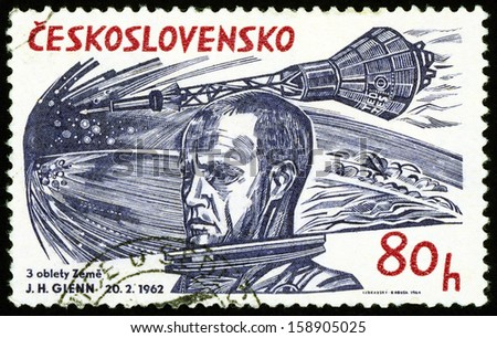 CESKOSLOVENSKO - CIRCA 1965: stamp printed in Czech (Czechoslovakia) shows US Marine Corps pilot, astronaut John H. Glenn (first  American to orbit Earth); Scott 1235 A472 80h blue red, circa 1965 - stock photo