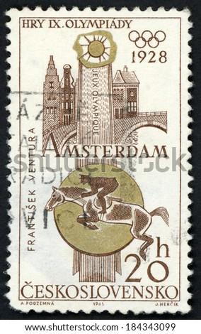 CESKOSLOVENSKO - CIRCA 1965: stamp printed in Czech shows horse rider Frantisek Ventura on Eliot in Equestrian, Amsterdam 1928; Czechoslovakian Olympic victories, Scott 1296 A493 20h brown, circa 1965 - stock photo