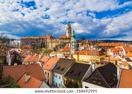 Cesky Krumlov castle and its tower with dramatic stormy sky, Czech Republic