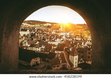 Cesky Krumlov Panorama Through The Castle Wall Window. Cesky Krumlov, Czechia, Europe. Sepia Color Grading.