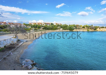 Cesme, Turkey - November 20, 2017 : Man is fishing at Kocakari Beach in Cesme Town of Izmir Province. Cesme is populer tourist destination in Turkey.