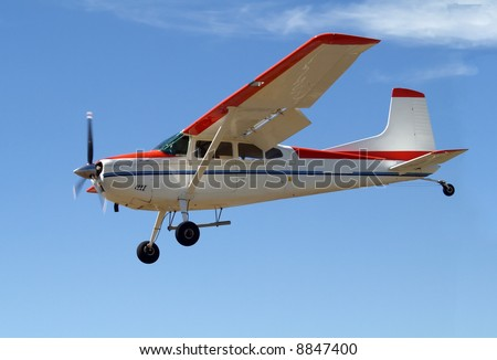 Cessna 180 coming in to land - stock photo