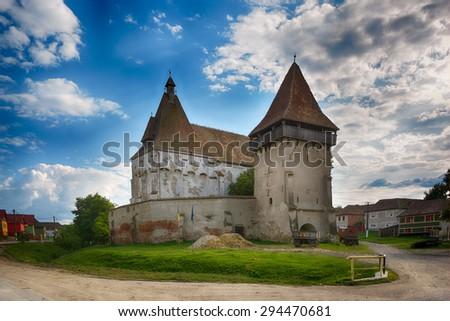 Cetatea de Balta fortified medieval church. (Kukullovar) medieval castle. Transylvania, Romania - stock photo