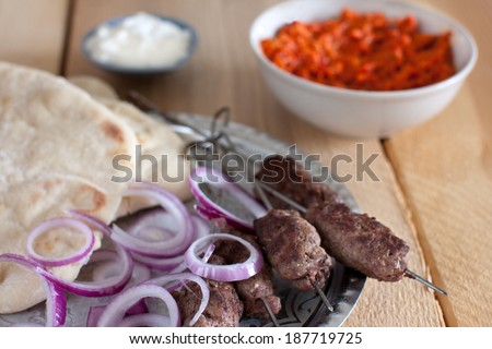 Cevapcici, a small skinless sausage with ajvar - stock photo