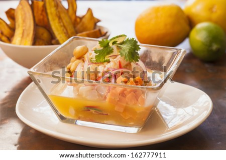Ceviche Peruano with sweet fried potatoes - stock photo