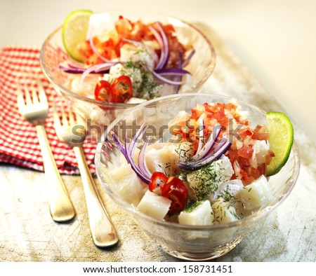 Ceviche. Peruvian food. Raw fish marinated on lime juice. - stock photo