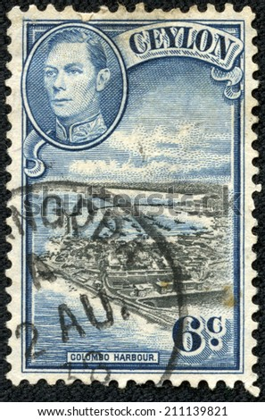 CEYLON-CIRCA 1937: An old ceylon postal stamp shows image of Colombo Harbour and King George VI, circa 1937 - stock photo