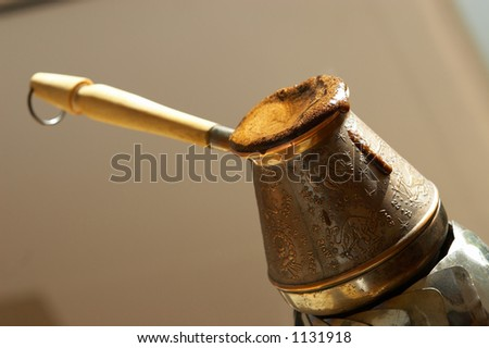 cezve and freshly made turkish coffee - stock photo