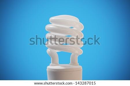 cfl bulb on blue background - stock photo