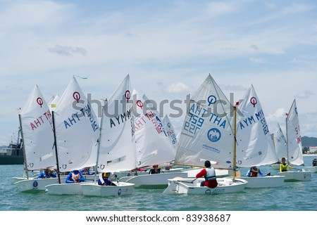 CHA-AM THAILAND - AUGUST 22: A group of unidentified optimist sailors gets ready to compete on Day 1 of 2011 Hua Hin Regatta on August 22, 2011 at Dusit Thani Resort & Spa Hua Hin in Cha-Am, Thailand