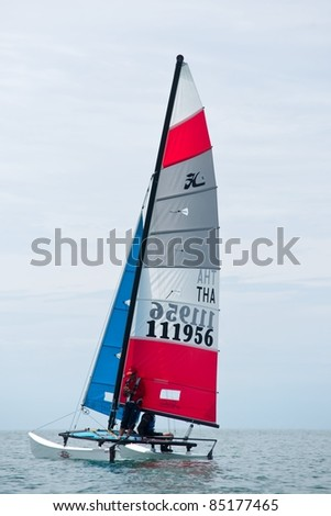 CHA-AM THAILAND - AUGUST 26: An unidentified Hobie sailboat from Thailand competes during Day 4 of the 2011 Hua Hin Regatta on August 26, 2011 at Dusit Thani Resort & Spa Hua Hin in Cha-Am, Thailand