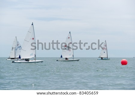 CHA-AM THAILAND - AUGUST 23: Group of unidentified sailors from Thailand compete on Day 2 of the 2011 Hua Hin Regatta on August 23, 2011 at Dusit Thani Resort & Spa Hua Hin in Cha-Am, Thailand